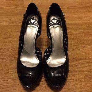 Black patten peep-toe heels